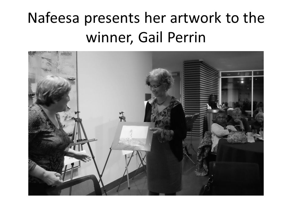 Nafeesa presents her artwork to the winner, Gail Perrin