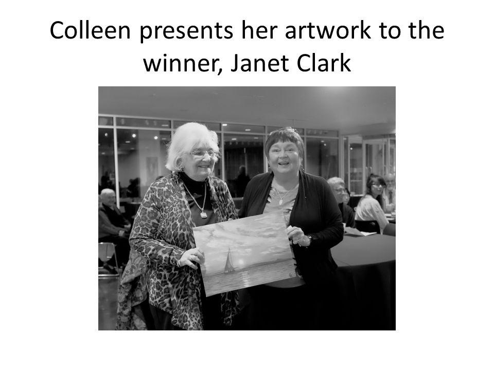 Colleen presents her artwork to the winner, Janet Clark