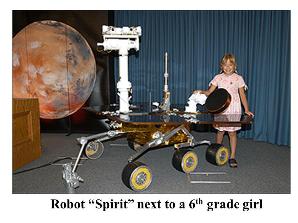 Robot Spirit next to a 6 th grade girl