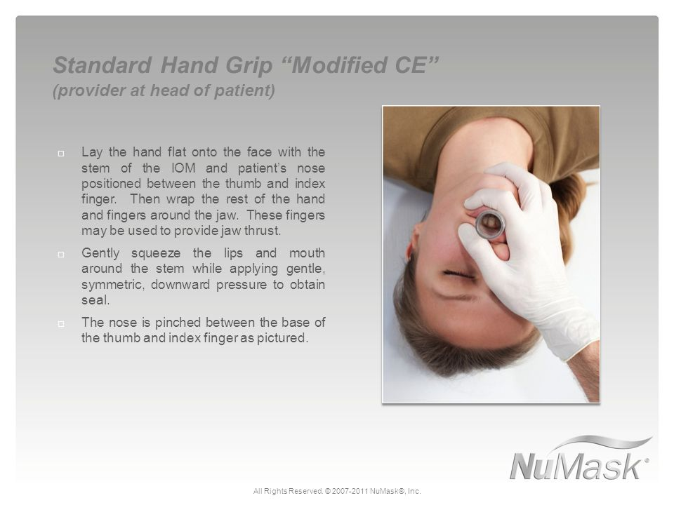  Lay the hand flat onto the face with the stem of the IOM and patient's nose positioned between the thumb and index finger. Then wrap the rest of the