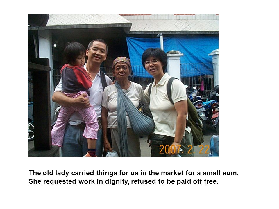 The old lady carried things for us in the market for a small sum.
