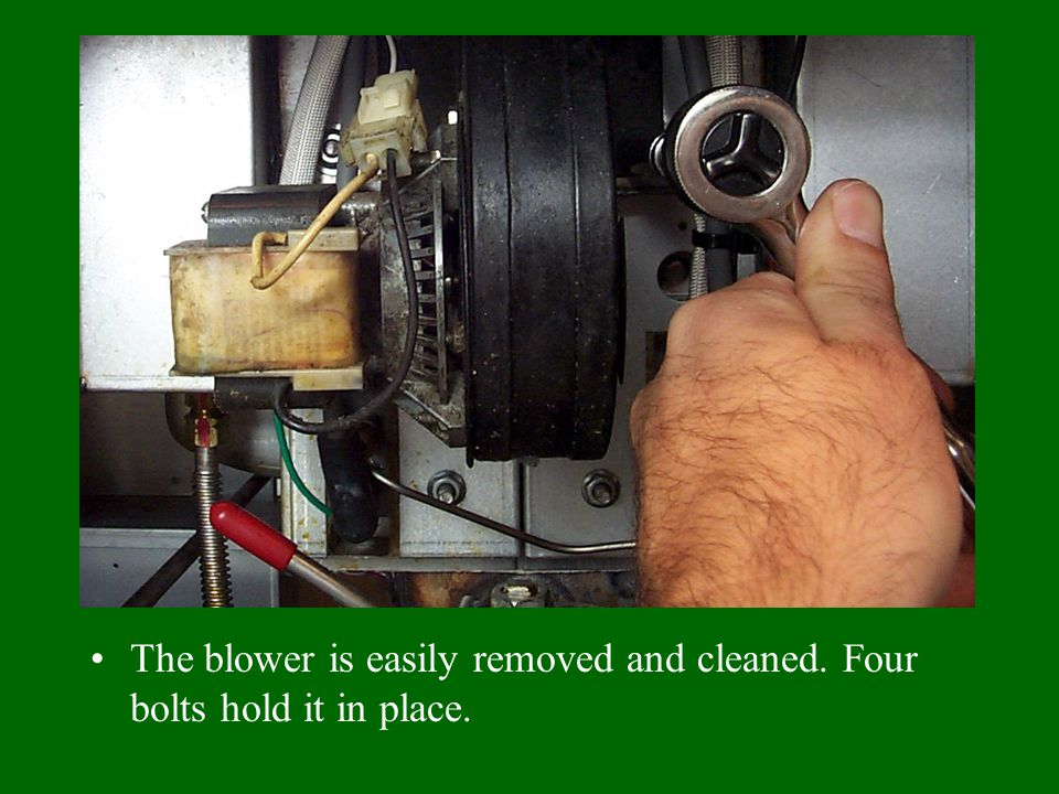 The blower is easily removed and cleaned. Four bolts hold it in place.