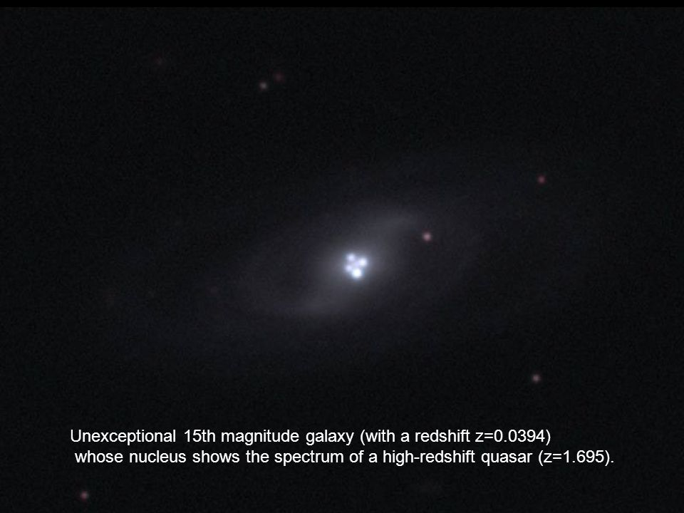 Unexceptional 15th magnitude galaxy (with a redshift z=0.0394) whose nucleus shows the spectrum of a high-redshift quasar (z=1.695).