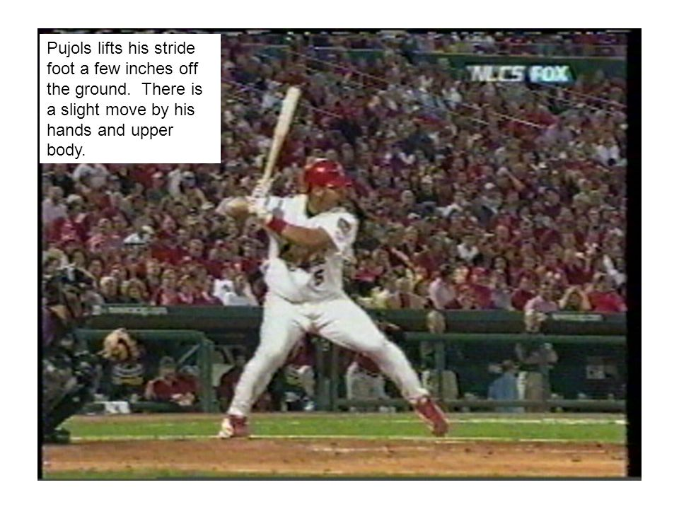 Top hand releases well into follow- through and more weight has now come over back foot, allowing Pujols to finish in perfect balance.