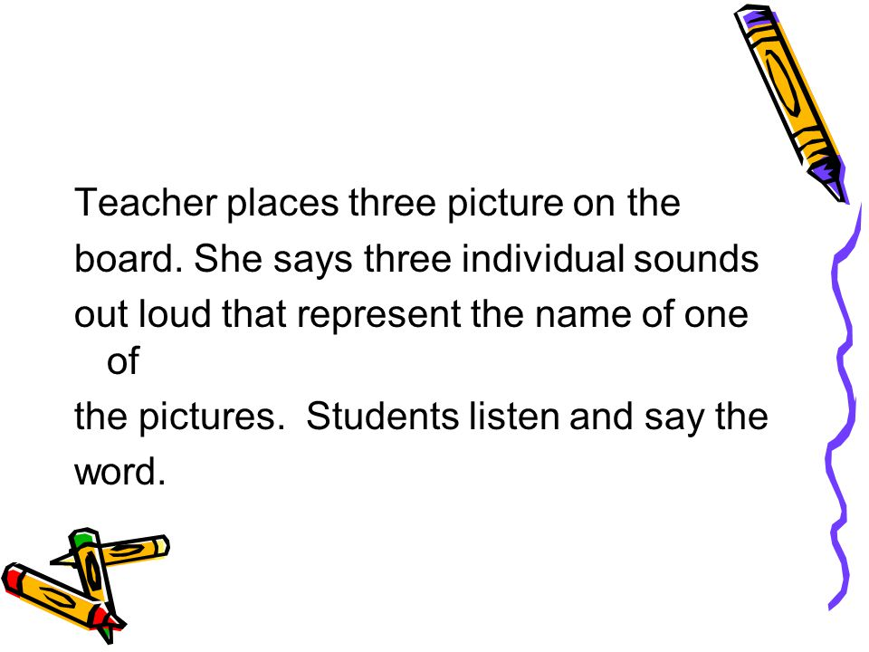 Teacher places three picture on the board.