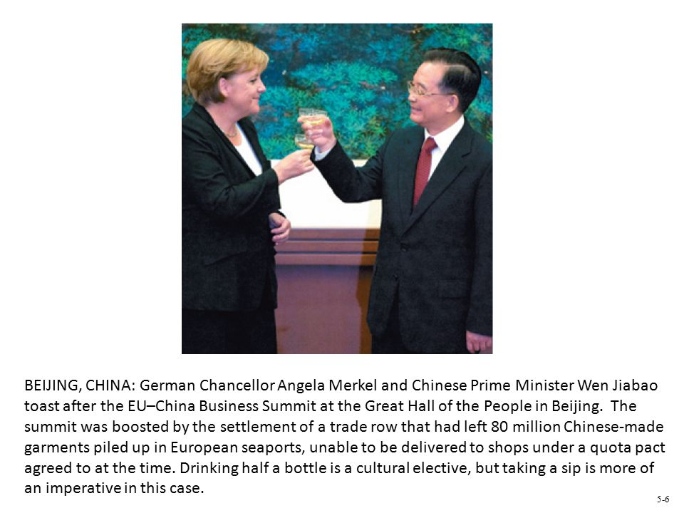 BEIJING, CHINA: German Chancellor Angela Merkel and Chinese Prime Minister Wen Jiabao toast after the EU–China Business Summit at the Great Hall of the People in Beijing.