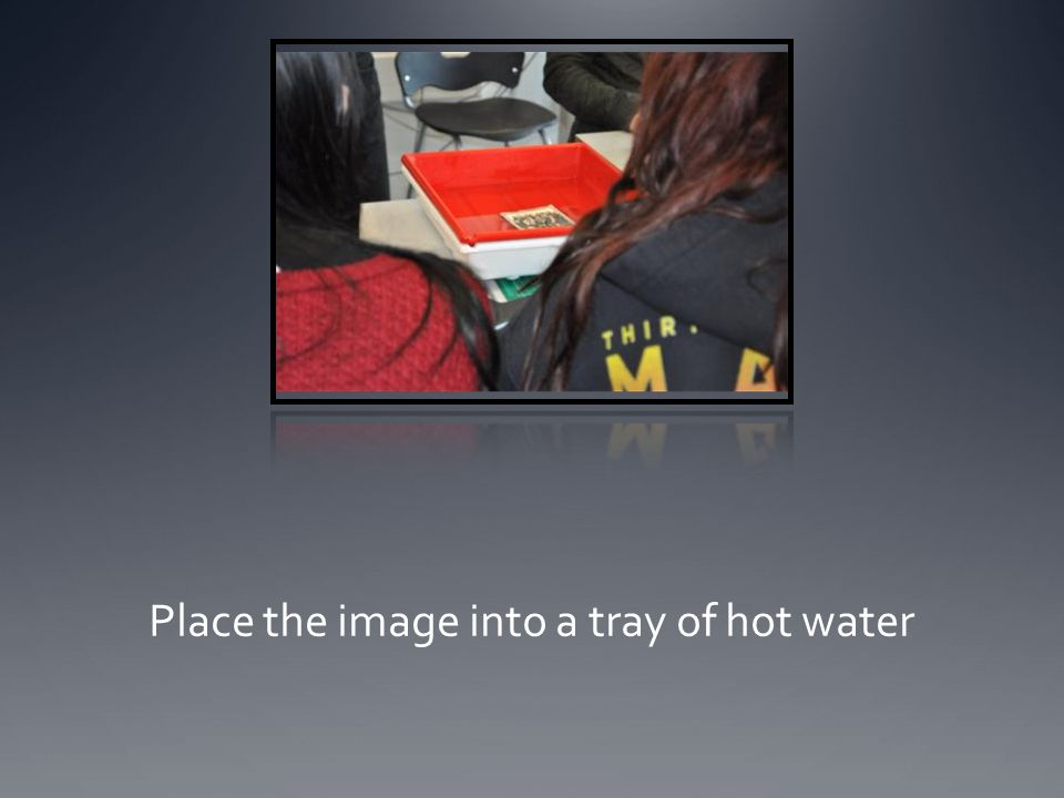 Place the image into a tray of hot water