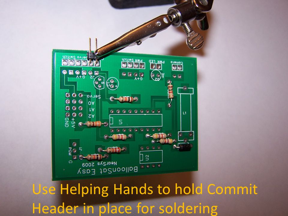Use Helping Hands to hold Commit Header in place for soldering
