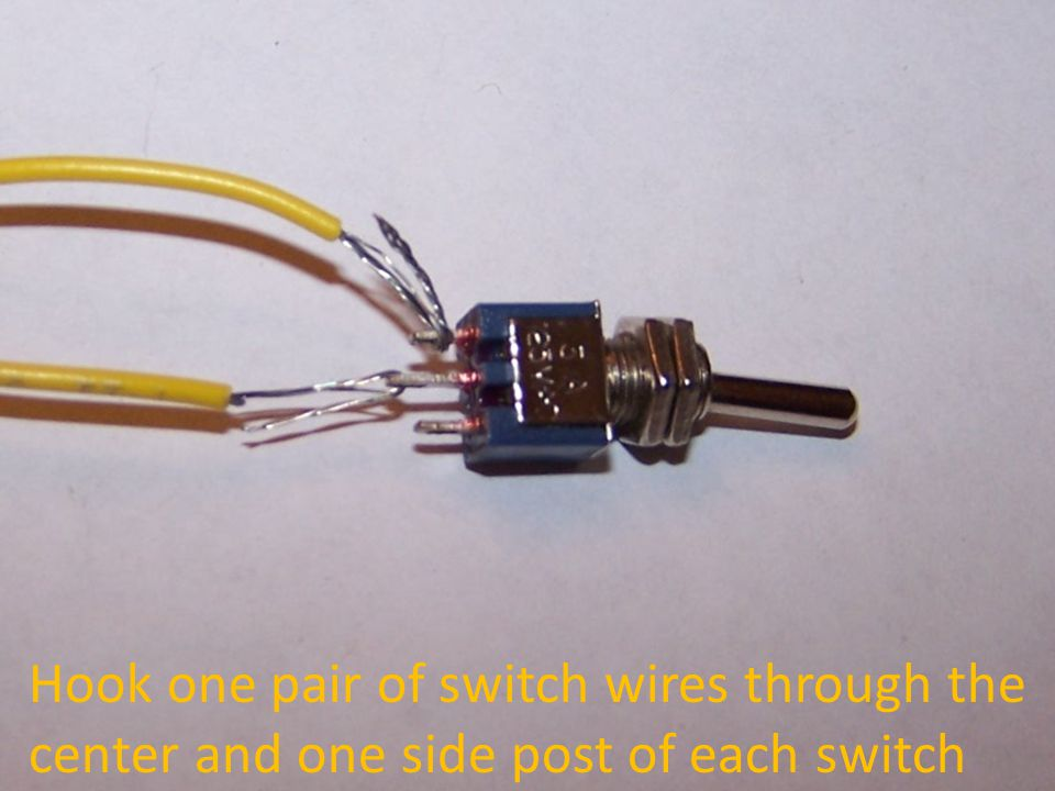 Hook one pair of switch wires through the center and one side post of each switch