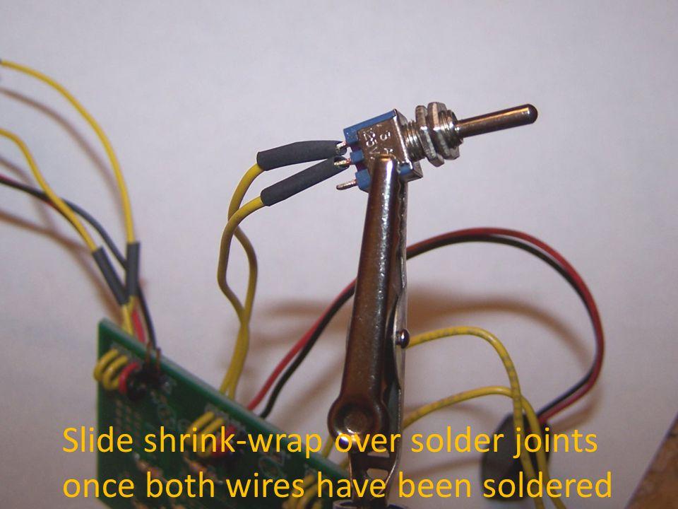 Slide shrink-wrap over solder joints once both wires have been soldered