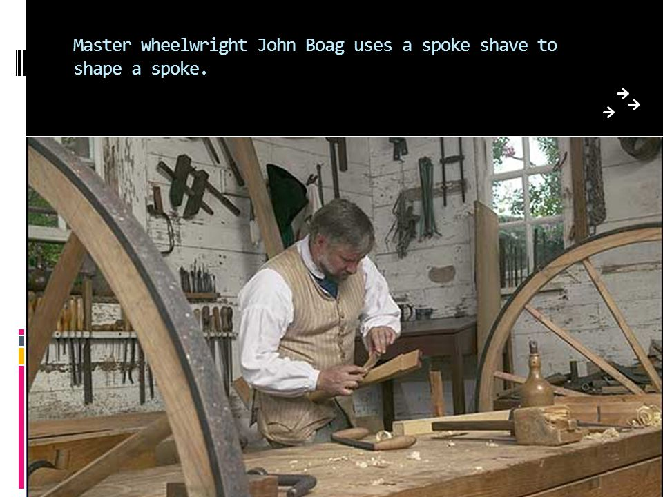 Master wheelwright John Boag uses a spoke shave to shape a spoke.
