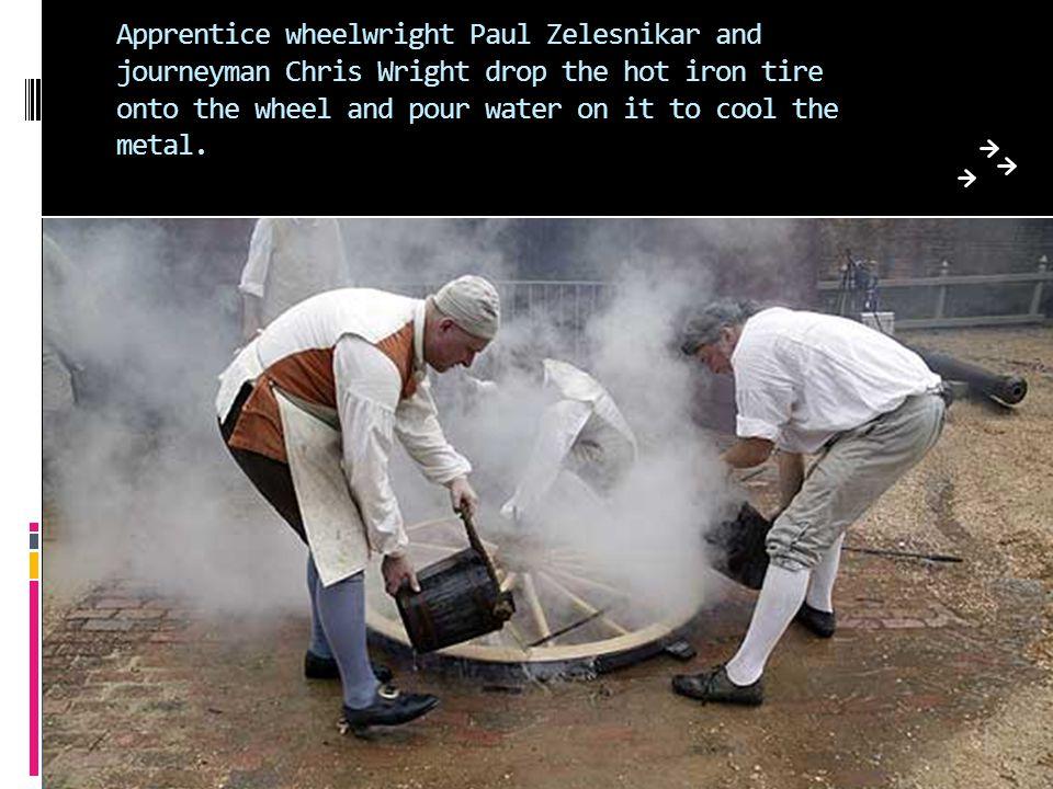 Master wheelwright John Boag and apprentice Paul Zelesnikar examine a wheel for a Windsor riding chair.
