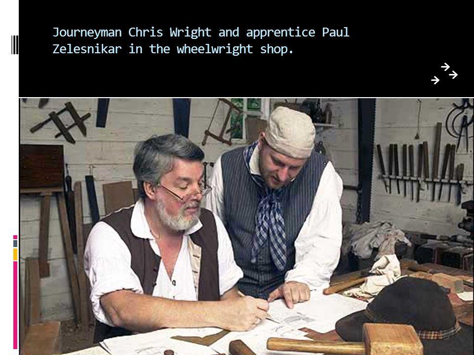 Journeyman Chris Wright and apprentice Paul Zelesnikar in the wheelwright shop.