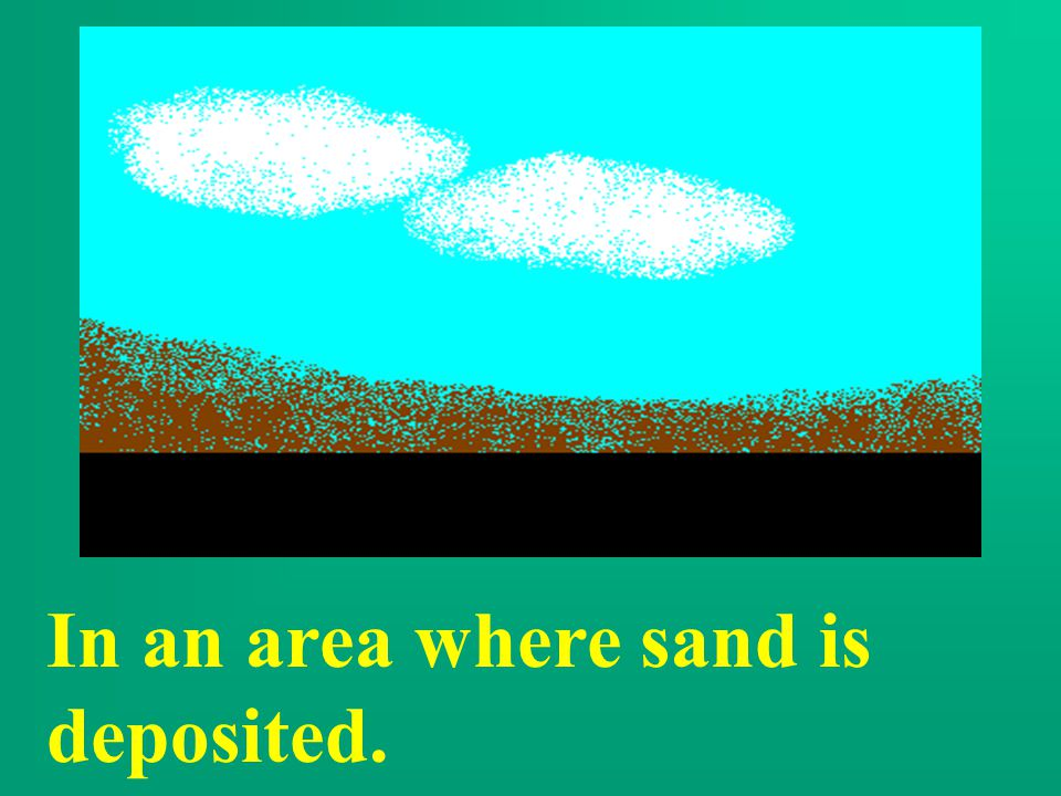 In an area where sand is deposited.