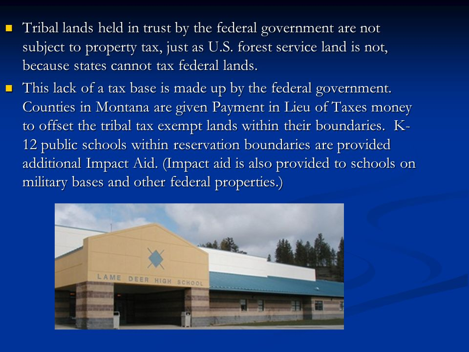 Tribal lands held in trust by the federal government are not subject to property tax, just as U.S. forest service land is not, because states cannot t