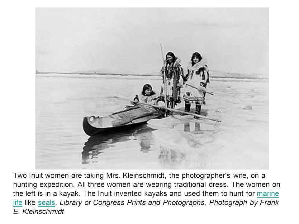 Two Inuit women are taking Mrs. Kleinschmidt, the photographer s wife, on a hunting expedition.