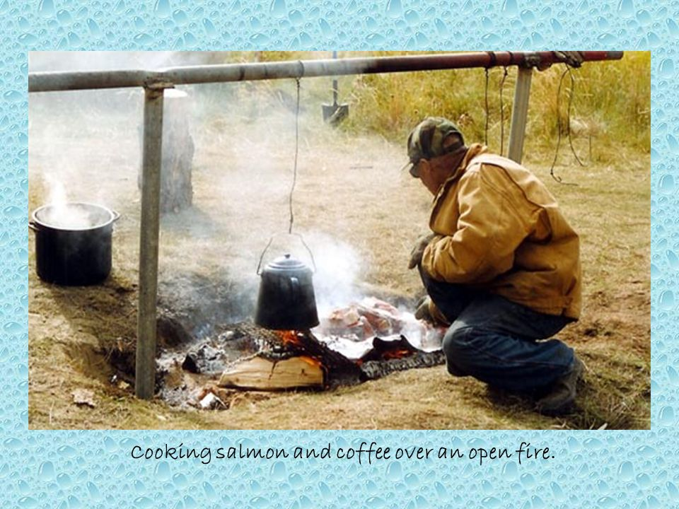 Cooking salmon and coffee over an open fire.