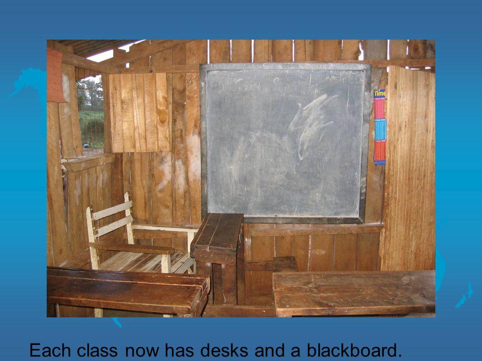 Each class now has desks and a blackboard.