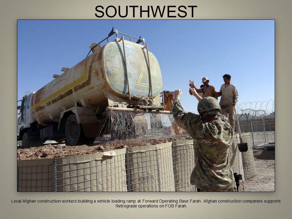 SOUTHWEST Local Afghan construction workers building a vehicle loading ramp at Forward Operating Base Farah. Afghan construction companies supports Re