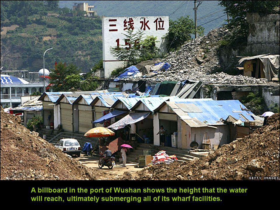 A billboard in the port of Wushan shows the height that the water will reach, ultimately submerging all of its wharf facilities.