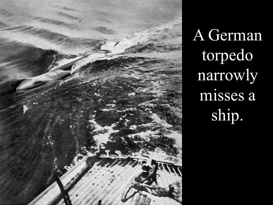 A German torpedo narrowly misses a ship.