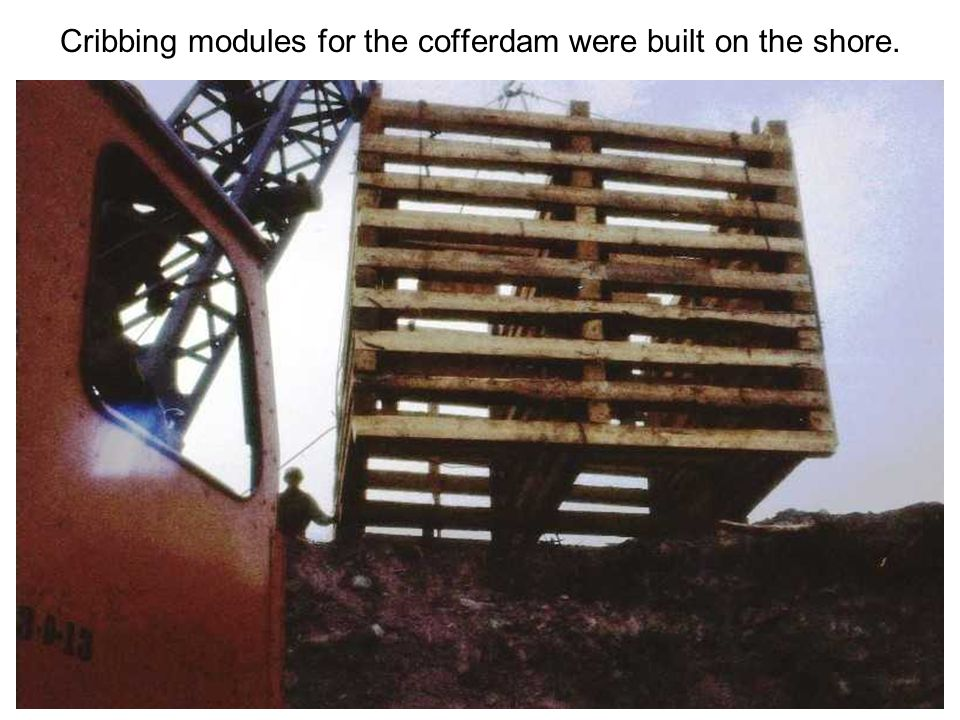 Cribbing modules for the cofferdam were built on the shore.