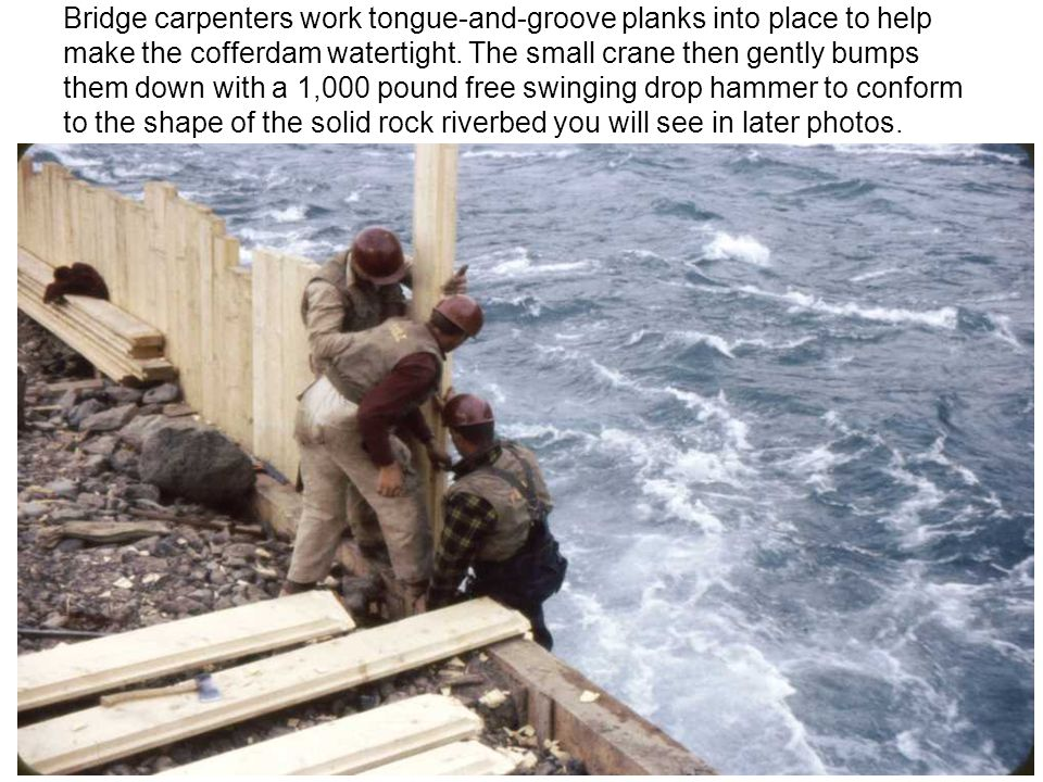 Bridge carpenters work tongue-and-groove planks into place to help make the cofferdam watertight.
