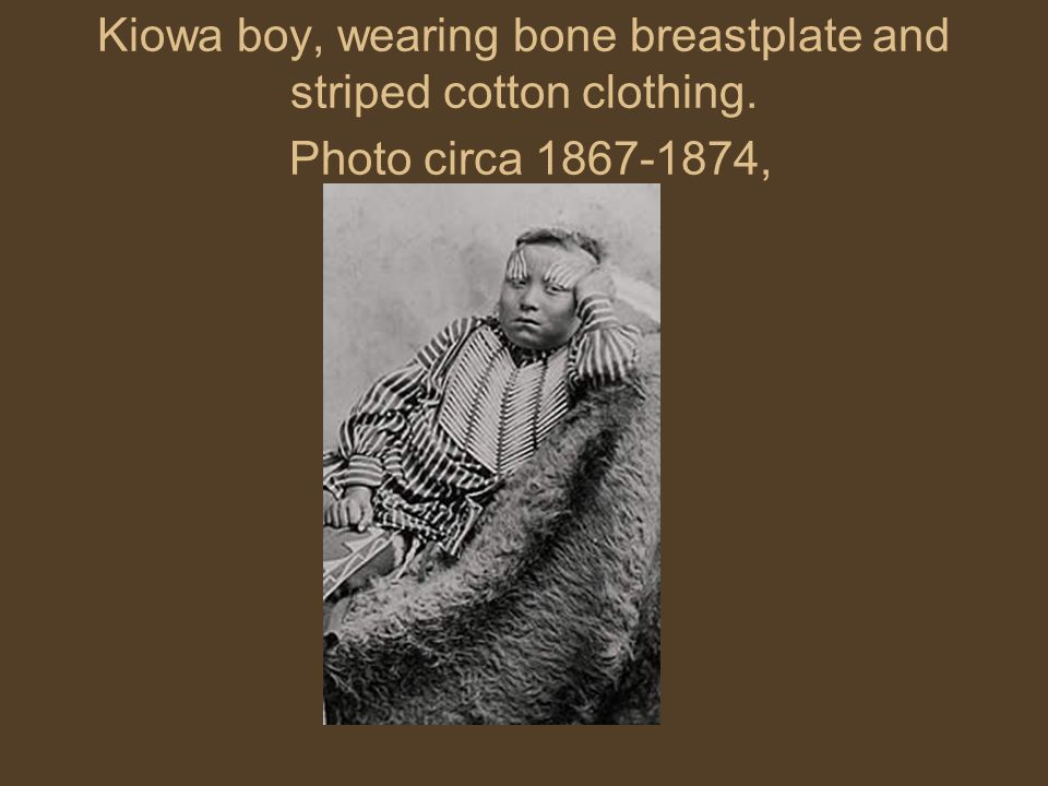 Kiowa boy, wearing bone breastplate and striped cotton clothing. Photo circa 1867-1874,