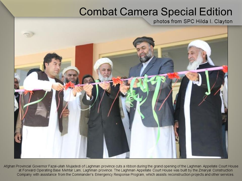 Afghan Provincial Governor Fazal-ullah Mujadedi of Laghman province cuts a ribbon during the grand opening of the Laghman Appellate Court House at Forward Operating Base Mehtar Lam, Laghman province.