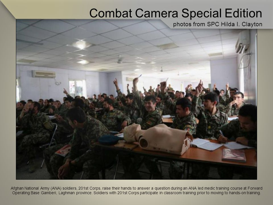 Afghan National Army (ANA) soldiers, 201st Corps, raise their hands to answer a question during an ANA led medic training course at Forward Operating Base Gamberi, Laghman province.