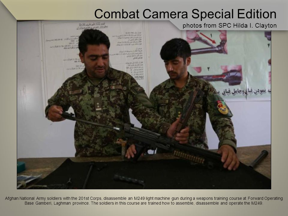 Afghan National Army soldiers with the 201st Corps, disassemble an M249 light machine gun during a weapons training course at Forward Operating Base Gamberi, Laghman province.