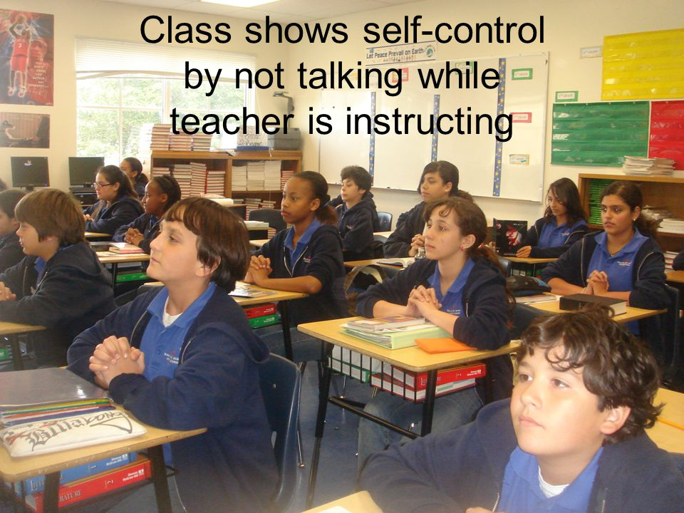 Class shows self-control by not talking while teacher is instructing