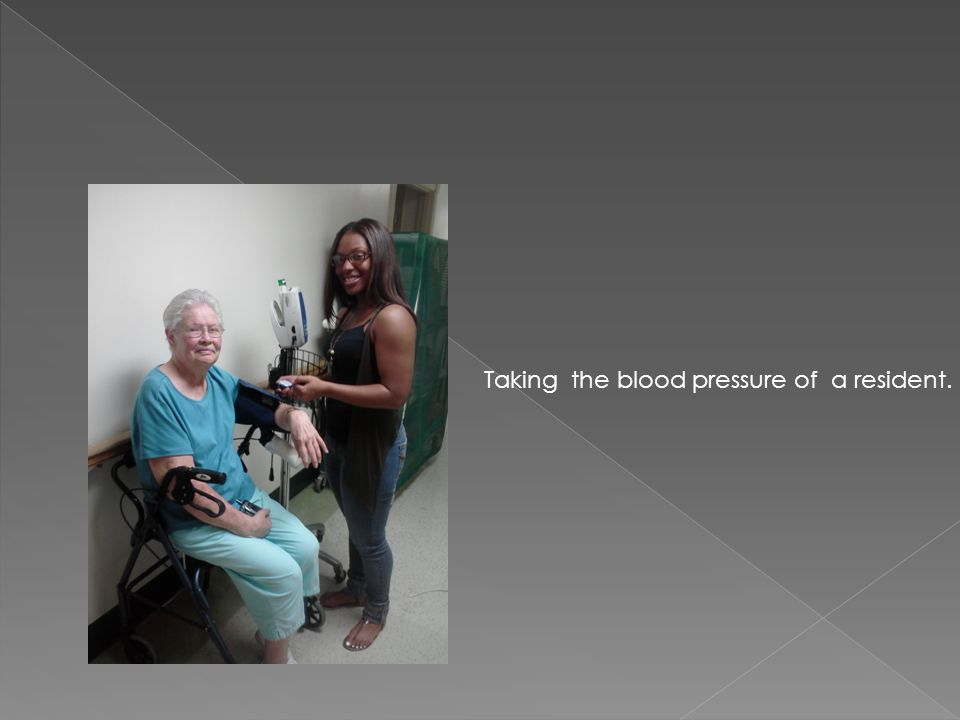 Taking the blood pressure of a resident.