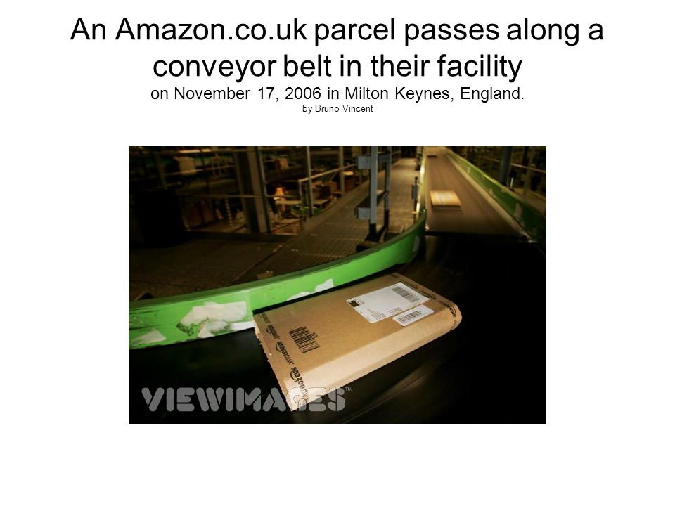 An Amazon.co.uk parcel passes along a conveyor belt in their facility on November 17, 2006 in Milton Keynes, England.