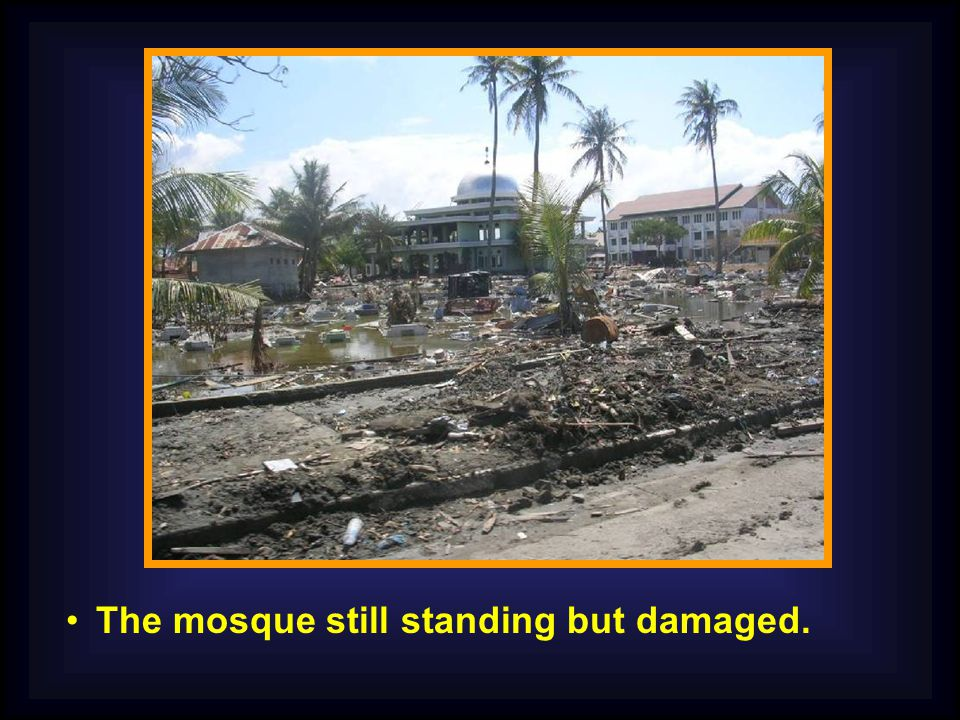 The mosque still standing but damaged.