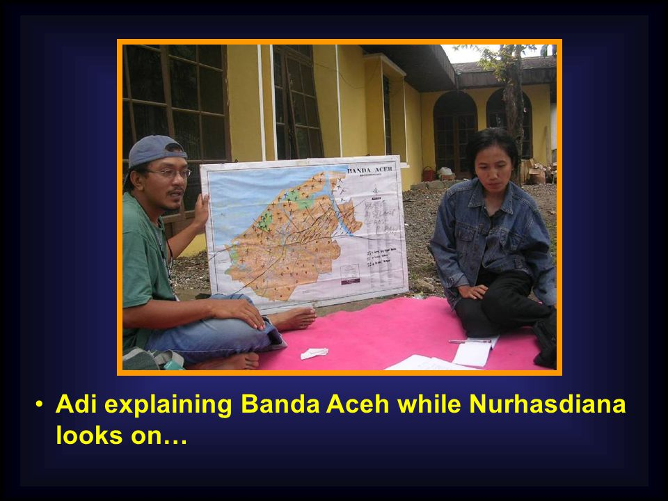 Adi explaining Banda Aceh while Nurhasdiana looks on…
