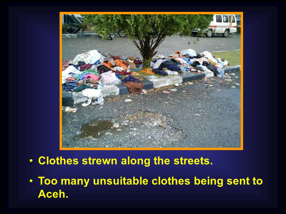 Clothes strewn along the streets. Too many unsuitable clothes being sent to Aceh.