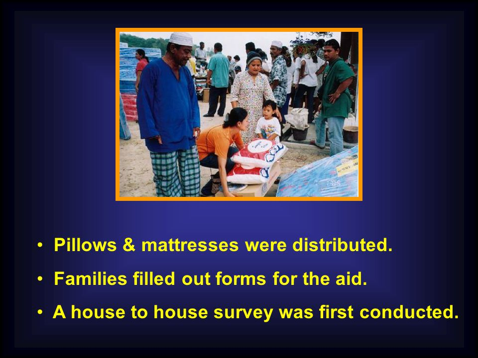 Pillows & mattresses were distributed. Families filled out forms for the aid.