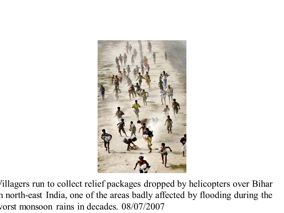 Villagers run to collect relief packages dropped by helicopters over Bihar in north-east India, one of the areas badly affected by flooding during the