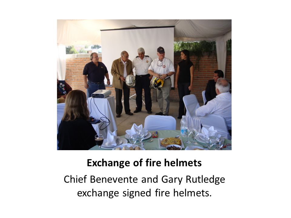 Exchange of fire helmets Chief Benevente and Gary Rutledge exchange signed fire helmets.