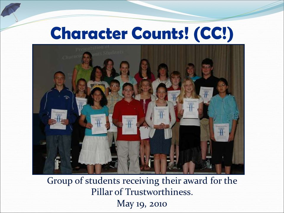 Character Counts. (CC!) Group of students receiving their award for the Pillar of Trustworthiness.
