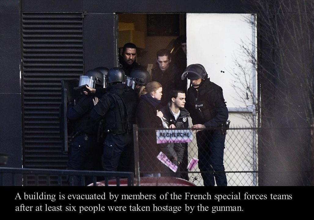 A police officer is dressed in body armour as the hostage-taker is believed to be armed with assault rifles.