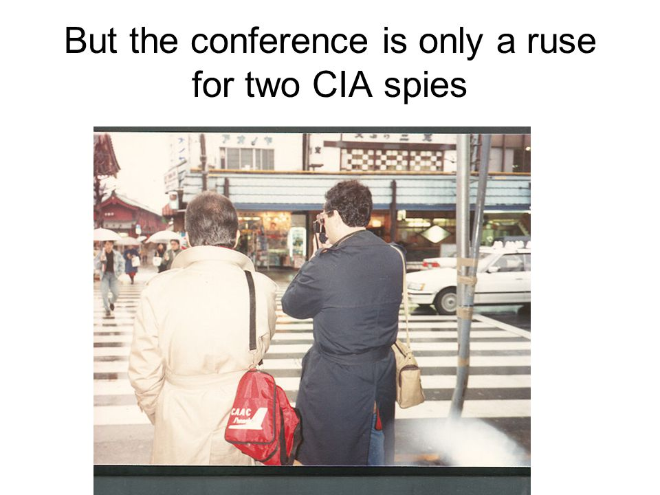 But the conference is only a ruse for two CIA spies