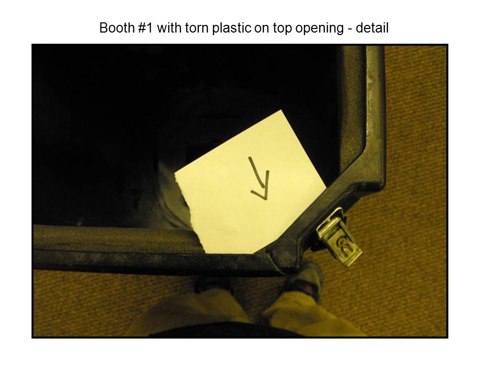 Booth #1 with torn plastic on top opening - detail