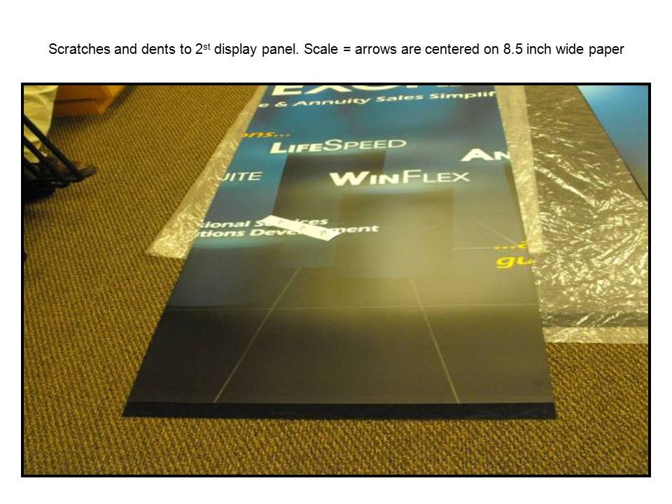 Scratches and dents to 2 st display panel. Scale = arrows are centered on 8.5 inch wide paper