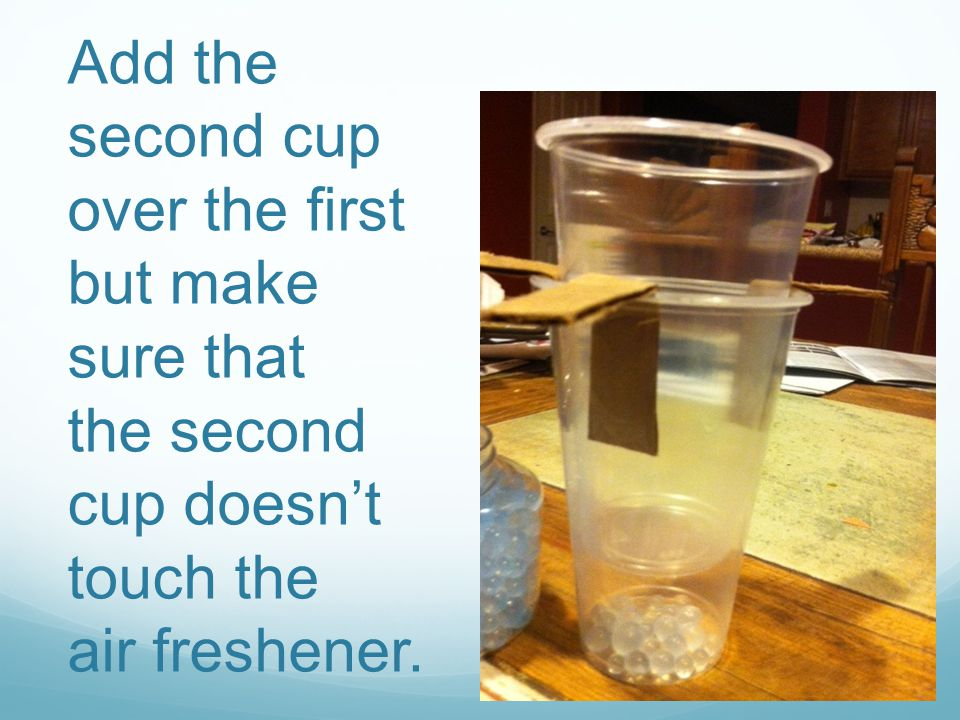 Add ice to the top cup but make sure no ice or water touches the freshener