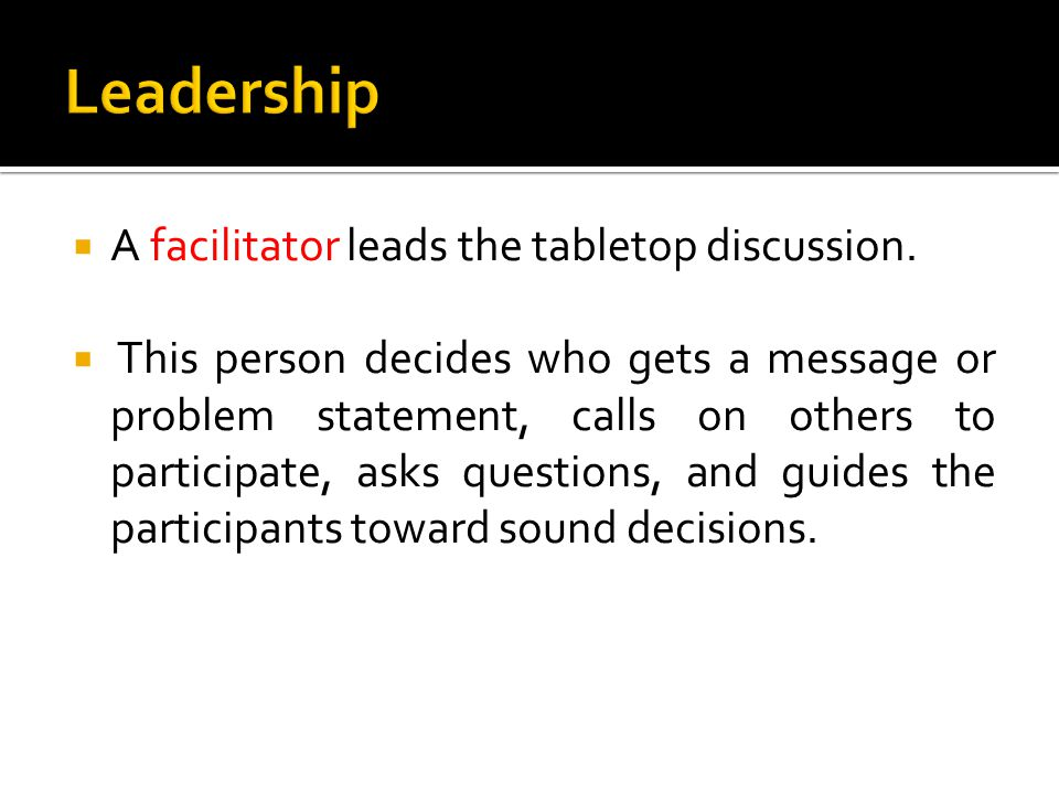  A facilitator leads the tabletop discussion.