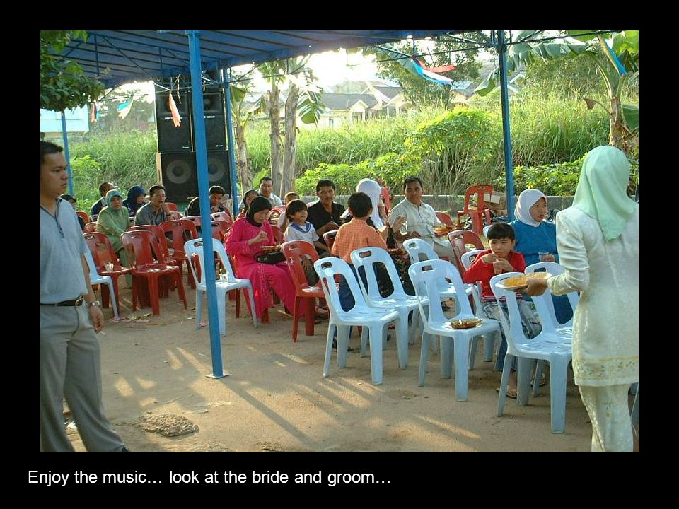 Enjoy the music… look at the bride and groom…