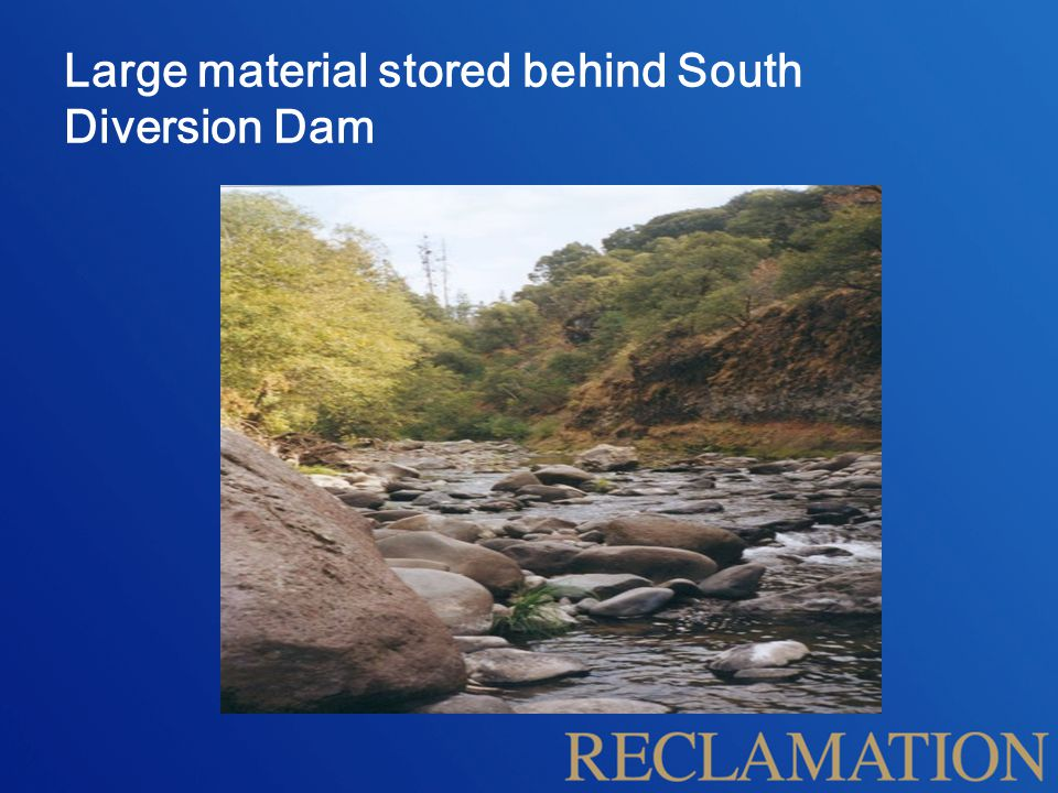 Large material stored behind South Diversion Dam