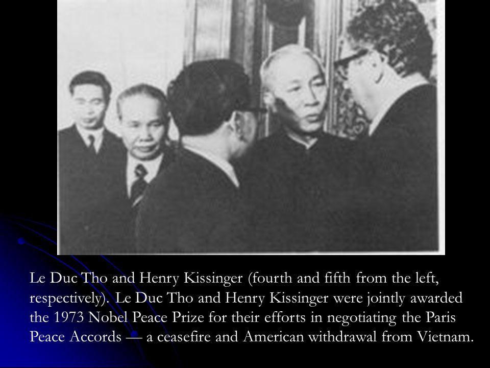 Le Duc Tho and Henry Kissinger (fourth and fifth from the left, respectively).